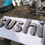 SushiPoint doosletters met led verlichting voorbereiden